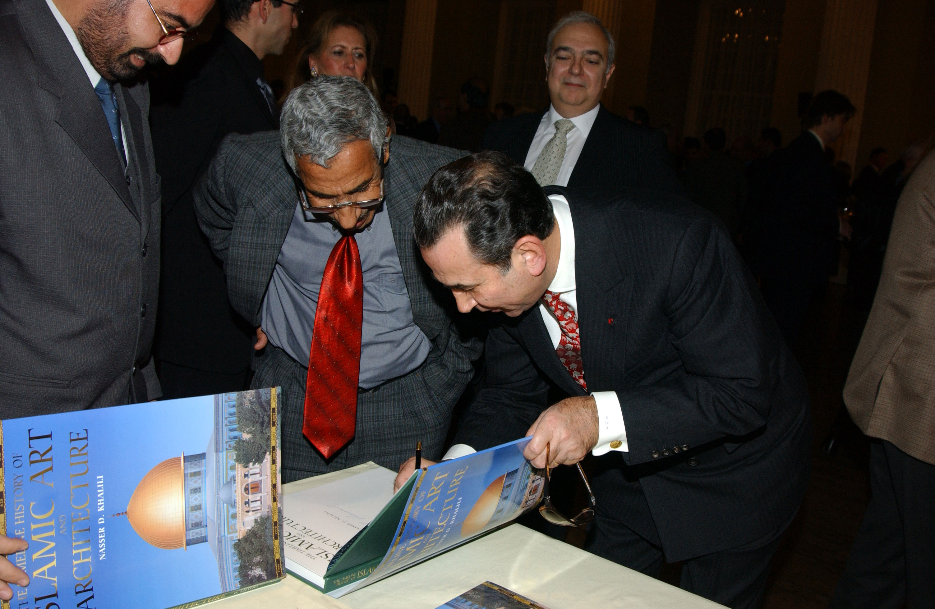 Professor Khalili signing the Book The Timeline History of Islamic Art And Architecture